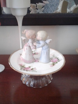 Kissing Angels from Mom's angel collection, on thrifted rose plate perched on glass desert bowl