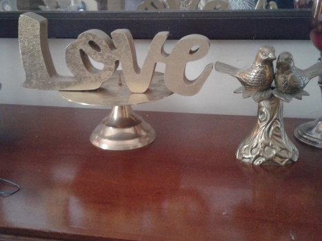 LOVE sign on thrifted candle plate and thrifted love birds